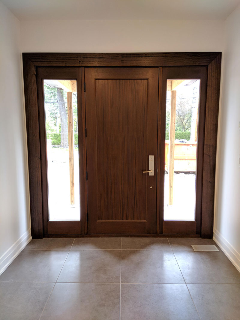 Photo of a large modern wooden door