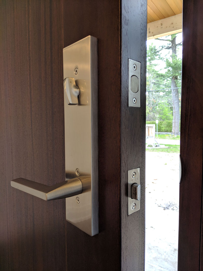 Photo of a modern door lock on a beautiful wooden door